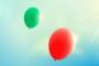 Bunte Luftballons vor sonnigem Himmel