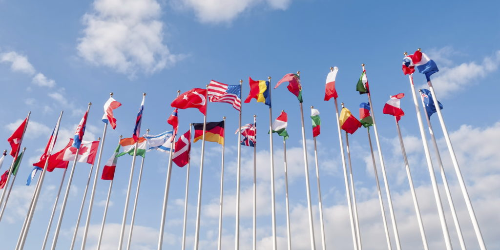 united-flags-on-blue-sky-background-000057091550_large