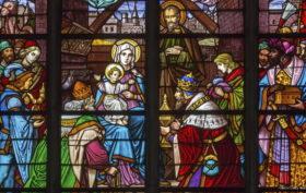 MECHELEN - SEPTEMBER 6: Three Magi scene from windowpane of St. Rumbold's cathedral on Sepetember 6, 2013 in Mechelen, Belgium.
