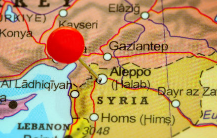 Close-up of a red pushpin on a map of Aleppo, Syria.