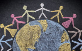 Group of people around the world. Chalk drawing.