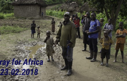 Chai, North Kivu, DRC- March 29, 2014: FDLR soldier walking with Rwandan refugees in Chai, North Kivu, DR Congo.