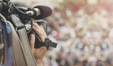 Cameraman shooting crowd