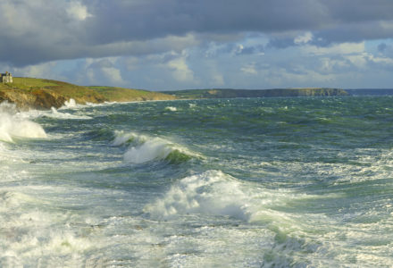 A panorama view of a very stormy sea and sky at Porthleven looking towards Loe Bar, Cornwall, United Kingdom