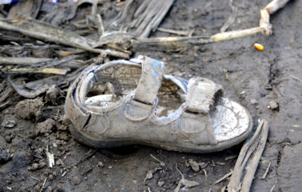 Sid, Serbia - October 2nd, 2015: Child shoe lost by Syrian refugees on their way to European Union States, on a dirt path near the Serbia - Croatia border.
