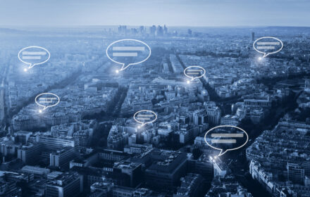 online communication concept, social network with speech bubbles on blue cityscape background