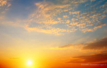 Cloudy sky and bright sunrise over the horizon. Wide photo.